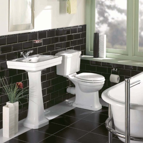 The Basin and W.C but with white tiles and Norfolk showering bath.
