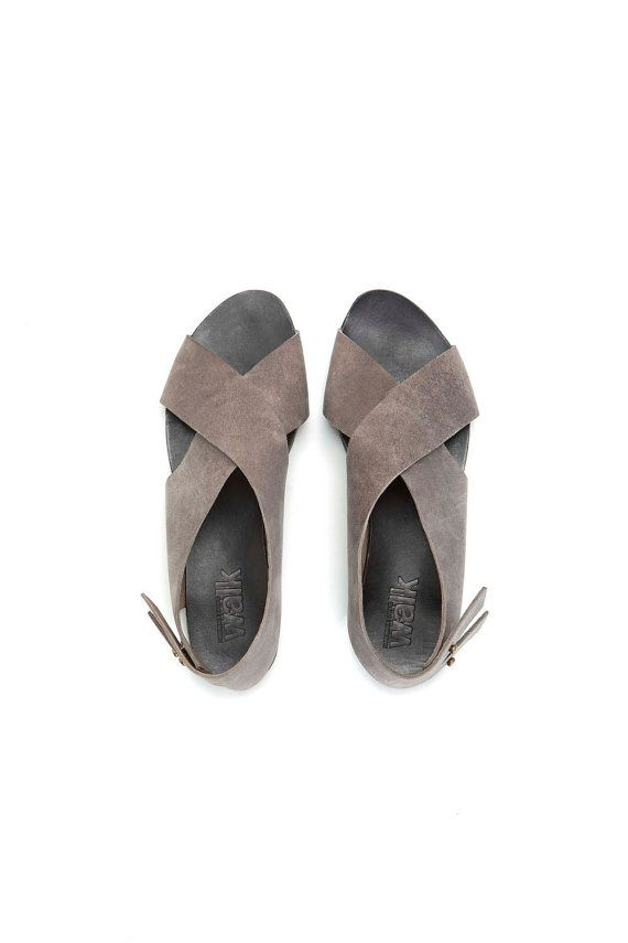 Someone get me these! Flat Crossed Grey sandals by WalkByAnatDahari on Etsy, $196