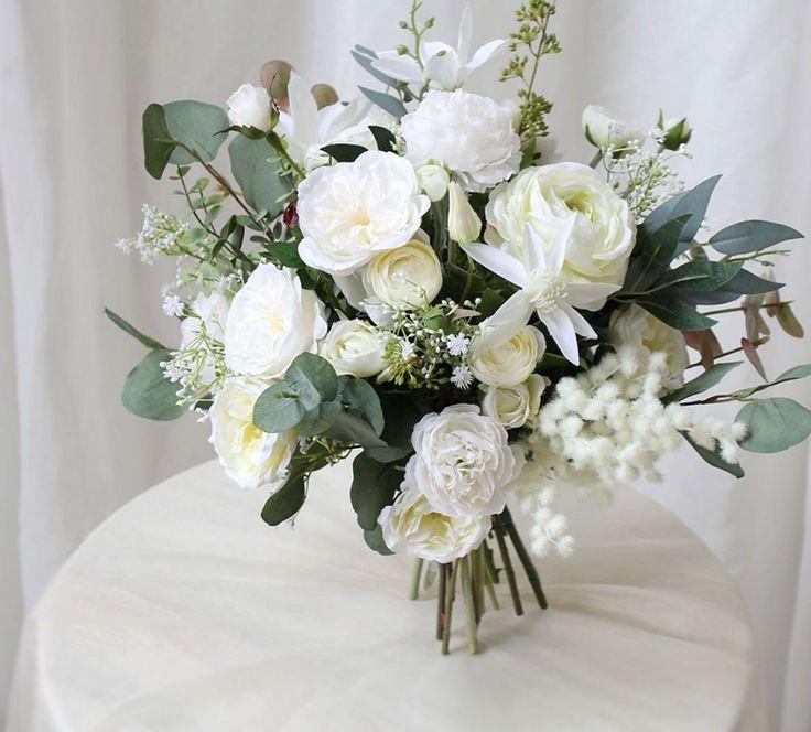 Creamy white austin rose ranunculus bouquet for weddings