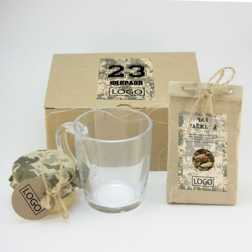 Подарок к 23 февраля из травяного чая  50 гр, баночки меда 150 гр. и кружки для чая. Для комплектации подарка используем сорта травяного чая, полезных для иммунитета:  - Сибиряк (Иван-чай, клюква, малина, почки сосны, смородина) или  - Таёжный (Иван-чай, почки сосны, рябина, душица, брусника, смородина) и виды меда: Луговой или Полевой
