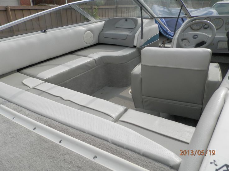 redesigned the old 1995 boat from 2 seats and a bench to wrap around seating with new upholstery