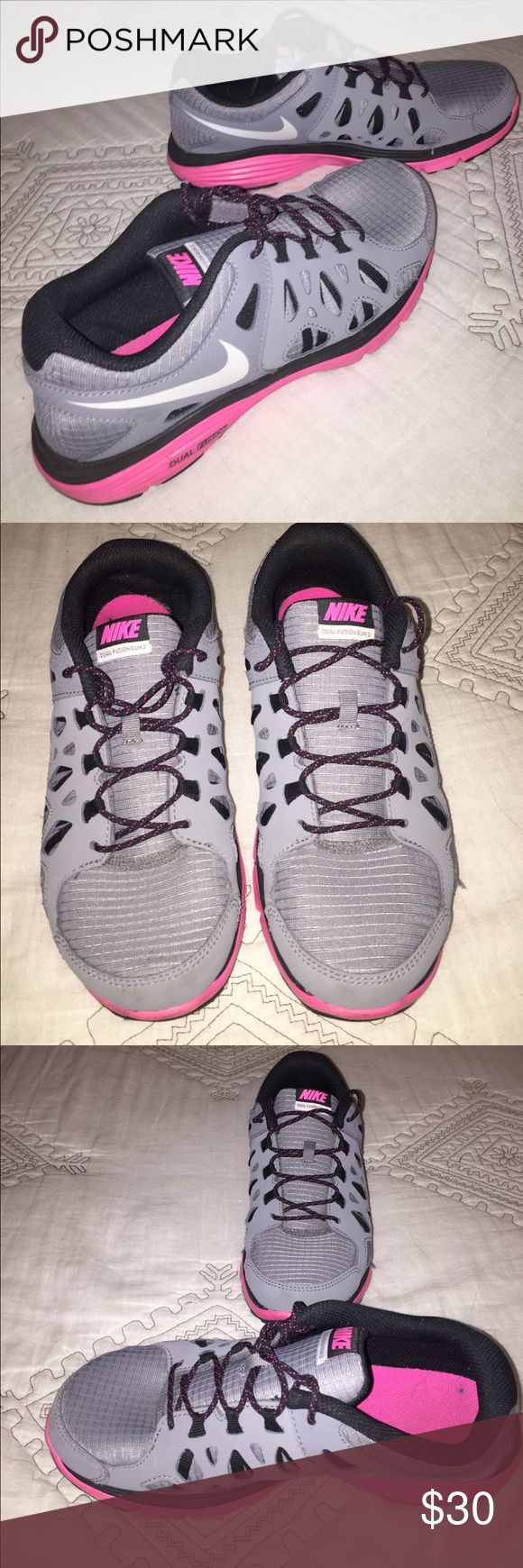 Nike Dual Fusion Run 2 Gray & Pink Nike Dual Fusion Run 2 shoes. Fits a size 8 for women. UK 6. EUR 39. 24.5 cm. The shoes look brand new, only worn about 3 times. The soles of the shoes are very clean. Nike Shoes Athletic Shoes
