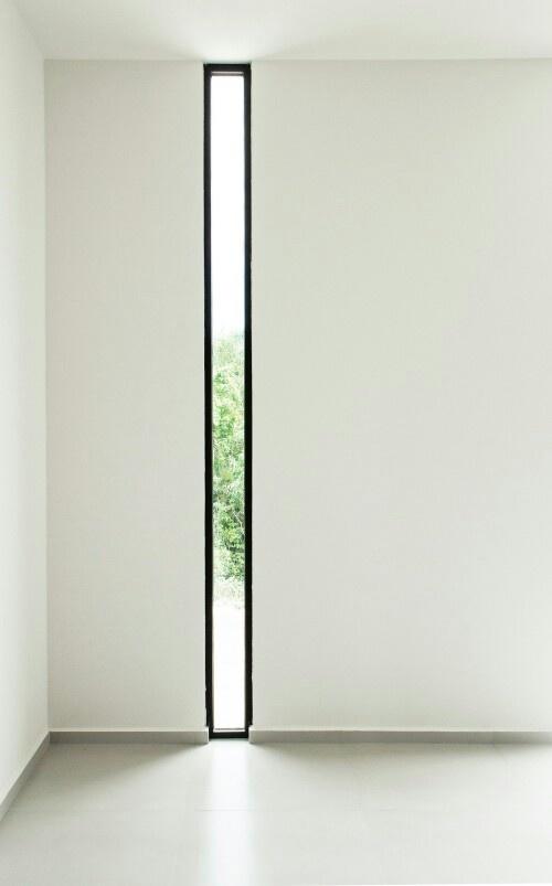 Thin full hight window adds a sneak peak of whats outside!