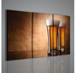 Una stampa su tela che immortala due boccali di birra: la luce soffusa ed il soggetto rendono il quadro adatto per un arredamento di pub, bar e ristoranti.