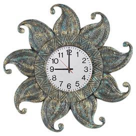 """Sun-shaped outdoor wall clock with a rustic finish.  Product: Wall clockConstruction Material: ResinColor: RusticFeatures: UV paint and UV lacquer for sun protectionDimensions: 24"""" Diameter"""