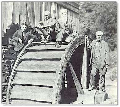 On an ancient waterwheel in West Virginia in 1918,the Four Vagabonds pose for a cameraman. Left to right are Harvey Firestone, Henry Ford, John Burroughs  and Thomas A. Edison.