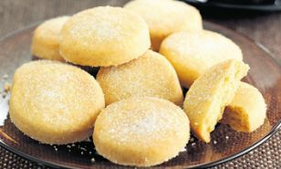Round off the meal by serving coffee with these crispy lemony shortbread biscuits. Leftovers can be stored in a tin for a week.