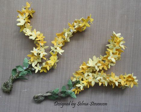 These are Forsythia branches I created using Susan's Garden Forsythia dies.  I have a tutorial on my blog.  http://selmasstampingcorner.blogspot.com/2014/05/susans-garden-forsythia-tutorial.html