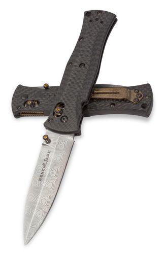 Benchmade Carbon fiber/damascus steel pocket knife.