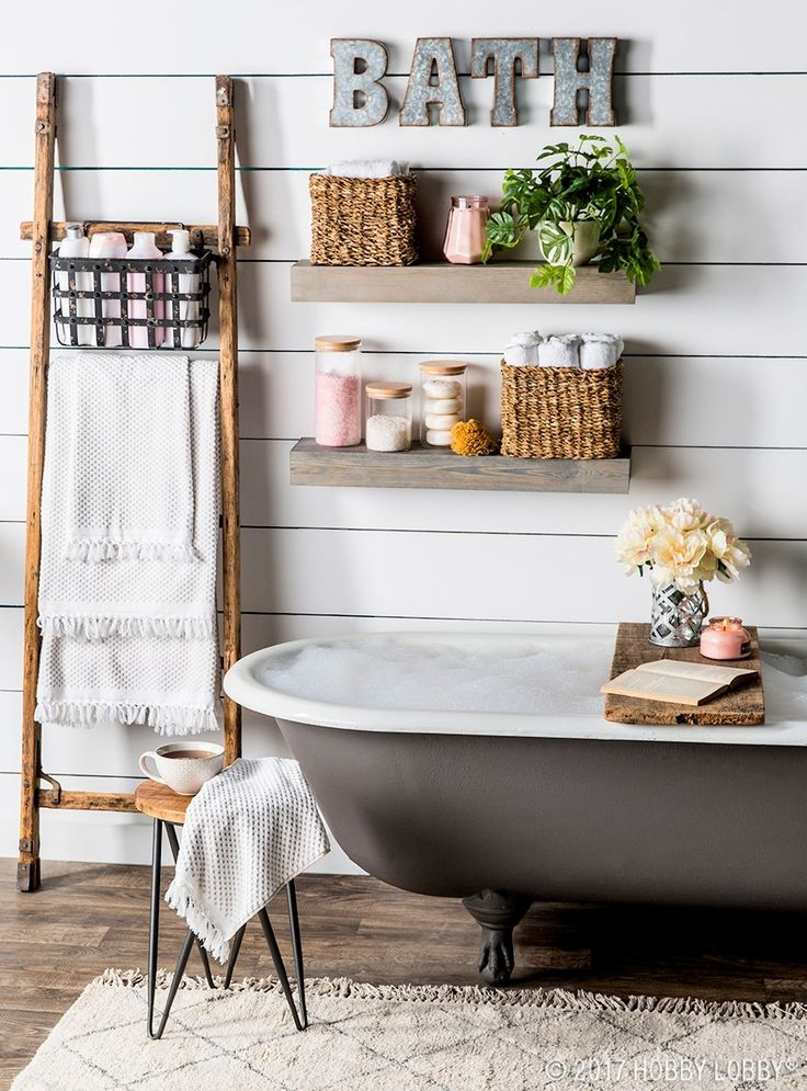 Turn your farmhouse bath into a relaxing oasis by adding elegant accents.