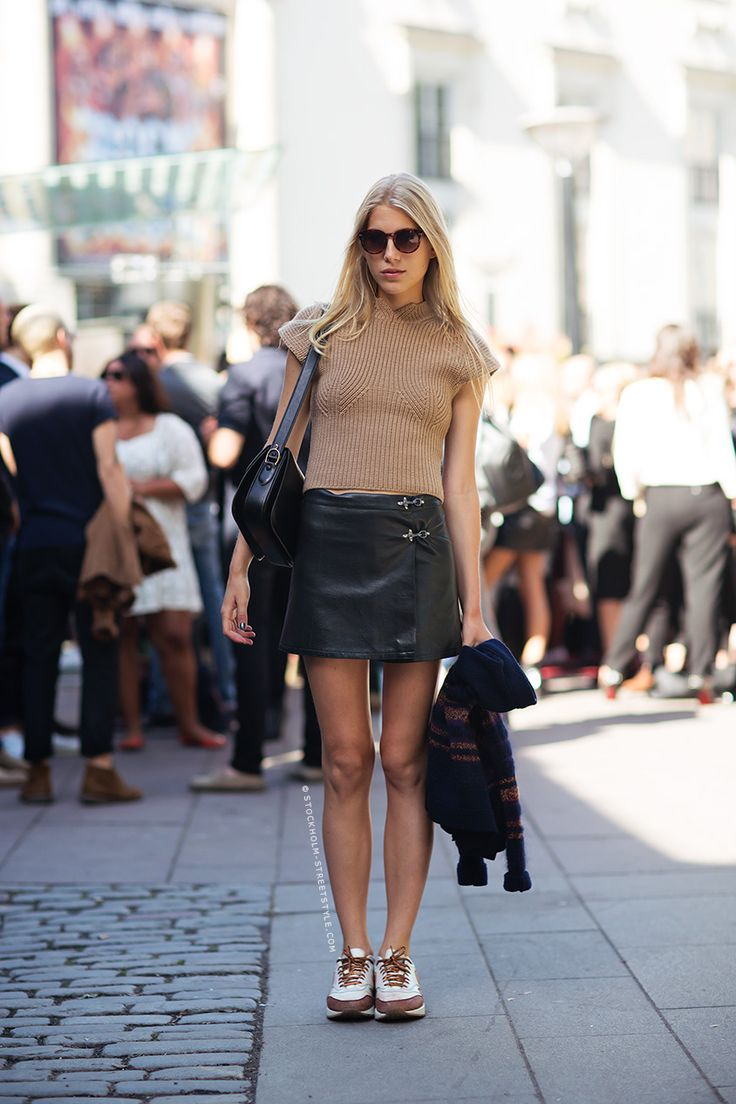 Brown sleeveless sweater + black leather skirt .Sneakers. Spring street casual women apparel ...