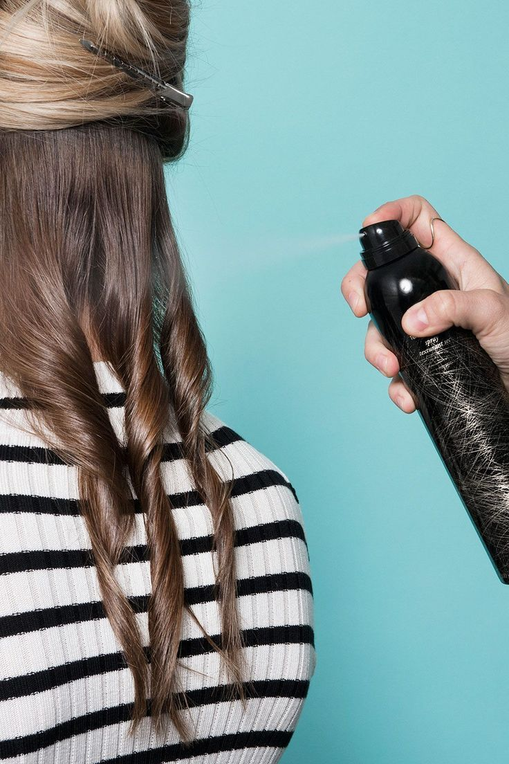 """The Secret Behind An L.A. Salon's Signature Waves #refinery29  http://www.refinery29.com/2016/03/105014/riawna-capri-waves-hairstyle-pictures#slide-4  Once the bottom section is done, layer in a texturizing spray and keep your hands off while the hair cools and the product sets. Oribe's Dry Texturizing Spray (seen here) is great for fine- to medium-weight locks, while the brand's <a href=""""http://www.oribe.com/apres-beach-wave-and-shine-spray-2.html"""" rel=..."""