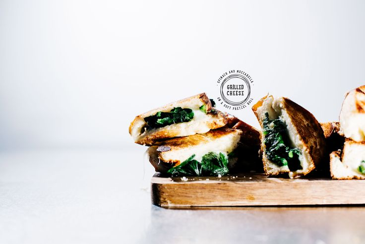Tender spinach and melted gooey mozzarella sandwiched between buttered and grilled pretzel roll slices.