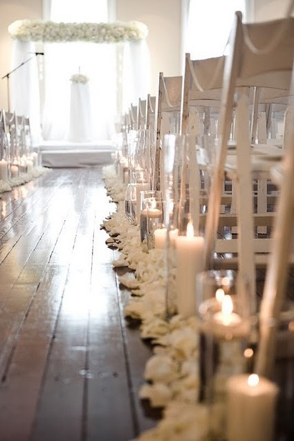 This is so pretty, but seriously ... all I see is a disaster waiting to happen. I'd SO be the guest to kick the candle over and burn down the wedding hall. That might be a bad omen, right?