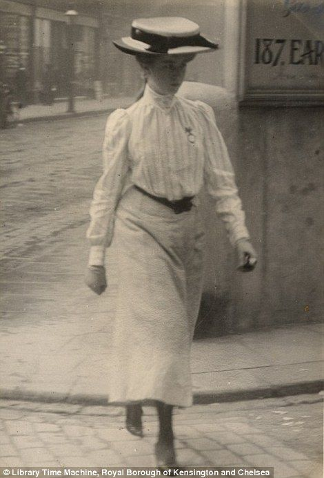 A young woman pictured in Cromwell Road, London on July 12th 1905 in a stylish white shirt with a belt and an ankle-length skirt