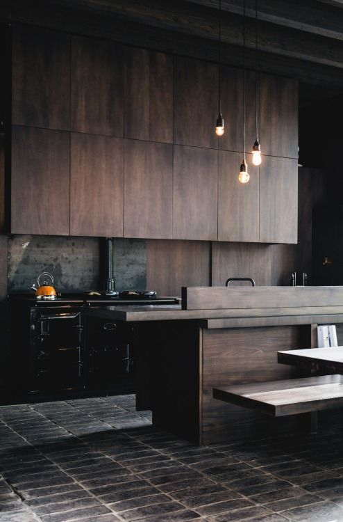 I like the concrete and dark mood and colored old stove contrasting the modern surroundings we could do the same but opposite. Modern stove and touches with old historical surroundings but still organized and streamlined design
