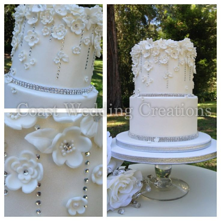 2 tier wedding cake finished with white fondant flowers and diamanté.