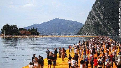 Thanks to a temporary work of art made of floating saffron-colored walkways, visitors to Lake Iseo in northern Italy can walk on water
