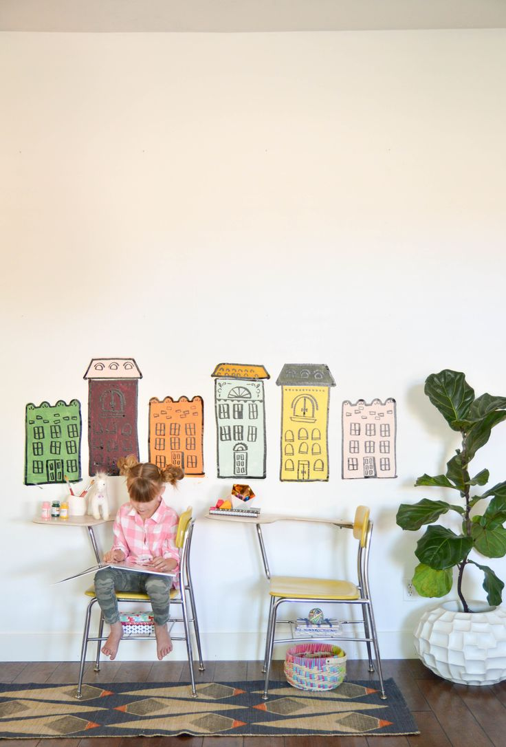 Vinyl Row Houses by Vintage Revivals add a little whimsey to any room. Made with the Cricut Explore machine. #CricutEverywhere