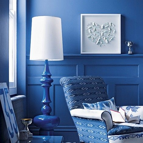 Cobolt blue may be my new favorite decorating shade. Gorgeous lamp, wall paint and chair.
