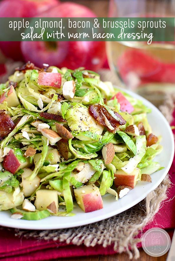 Apple, Almond, Bacon and Brussels Sprouts Salad with warm bacon dressing is a fresh and springy salad with lots of crunch! | iowagirleats.com