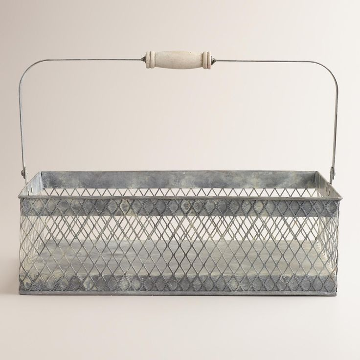Our vintage-inspired Rectangular Francine Wire Basket is perfect for storing cleaning supplies and small household items. This fun, rustic basket even features a swivel handle that makes it easy to tote around the house.