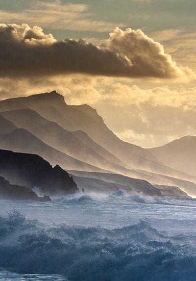 sea, sky, and mountains