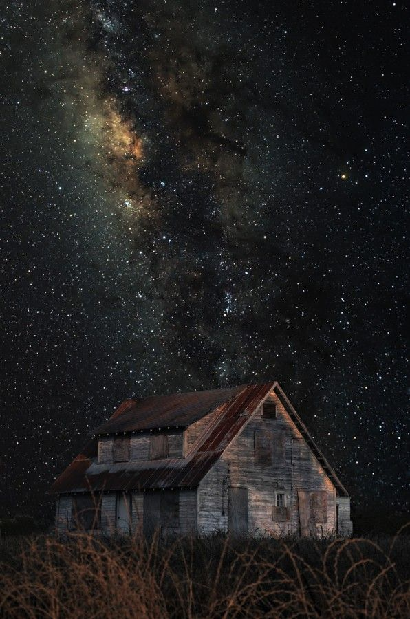 abandoned old house under the stars
