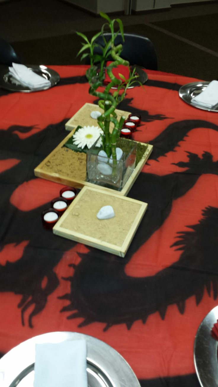Chinese themed centerpiece using wooden boxes, sand, lucky bamboo and pebbles
