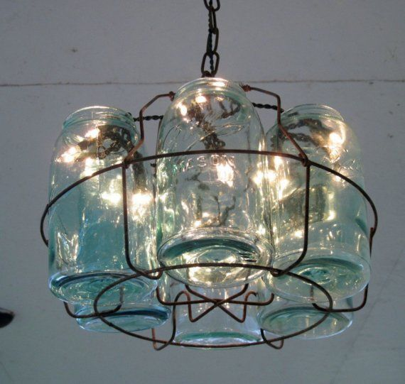 Vintage chandelier made from mason jars and wire canning basket. Great idea, saw the holder and didn't buy it of course. Next time.