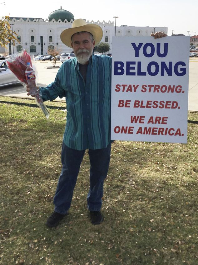Justin Normand, 53, held a sign saying 'you belong' outside a Dallas mosque last weekend after being angered by the hatred directed at Muslims during the recent presidential election