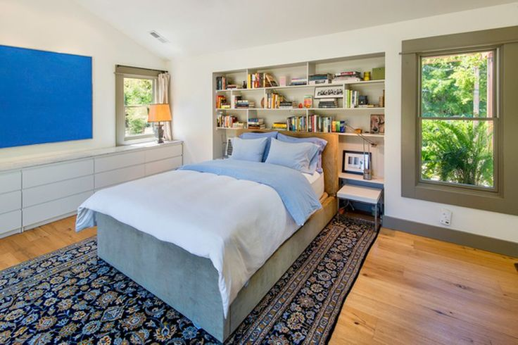 9689 Occidental Rd, Sebastopol, CA 95472 - Zillow; I like the efficiency of the built-ins on side and the bookshelves behind head. Great for a small bedroom!