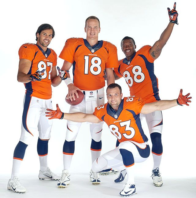 Denver Broncos Peyton Manning (18), Wes Welker (83), Eric Decker (87), and Demaryius Thomas (88) pose during a photo shoot on June 10, 2013.