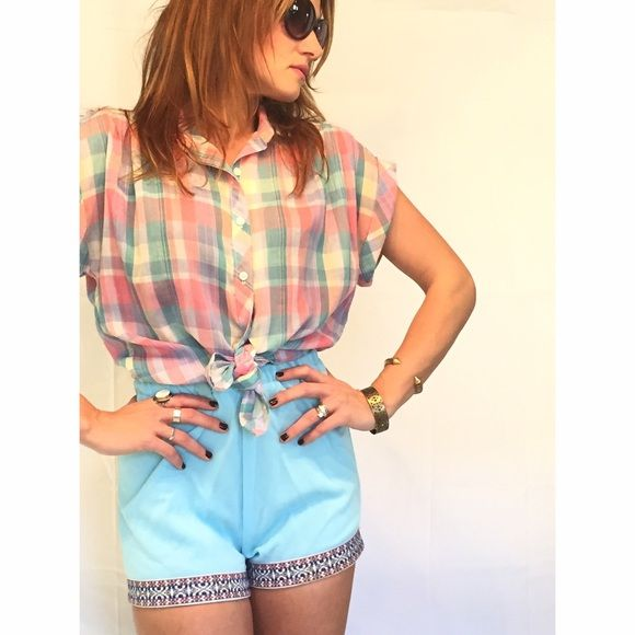 Vintage Plaid Shirt and Shorts Outfit Cute vintage lightweight and baggy button up plaid shirt with rolled cuff. Comes with blue shorts with elastic waist and embroidered trim detail. The shorts have some discoloration. Great summer outfit! Vintage Other