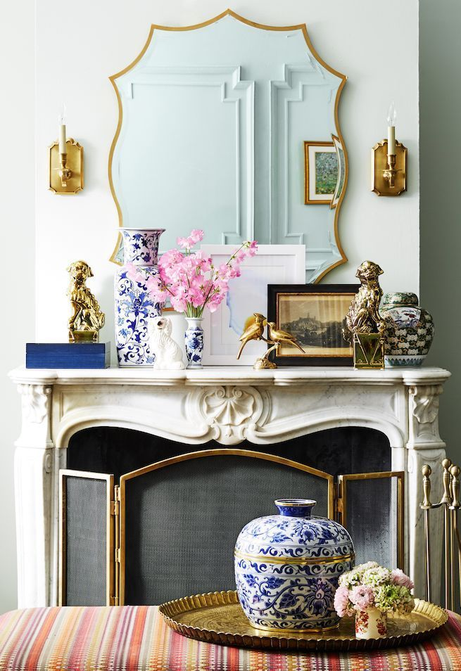 Adorn your carved marble fireplace with gilded gold accents and blue and white Chinoiserie for a bright, classic take on spring decor.