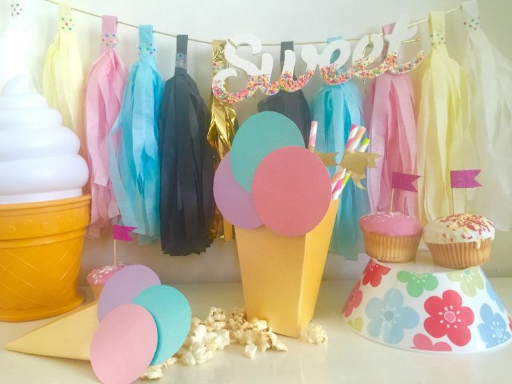 Image of Cake toppers, boxes, straws, candles and cups