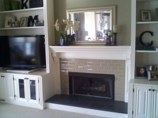Cabinets with tv and recessed fireplace