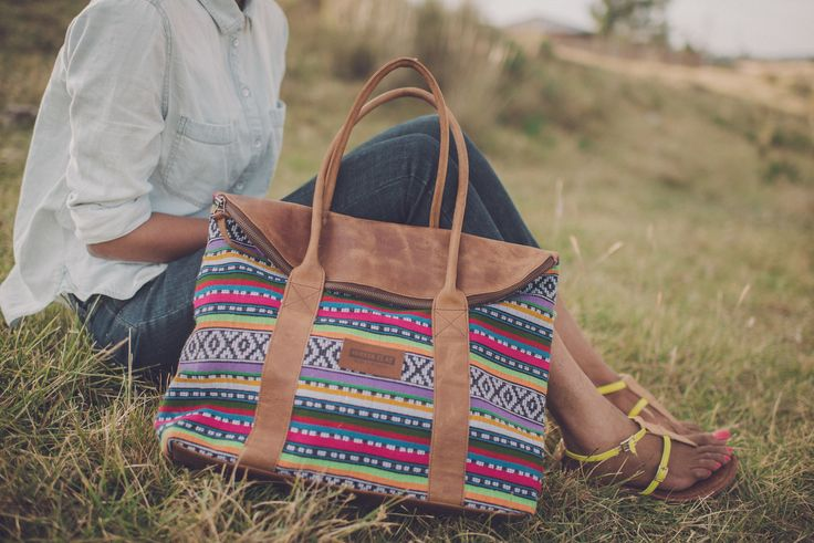 An elegant yet practical travel companion, this purse is crafted with premium leather on one side and handwoven fabric made in Ethiopia on t...