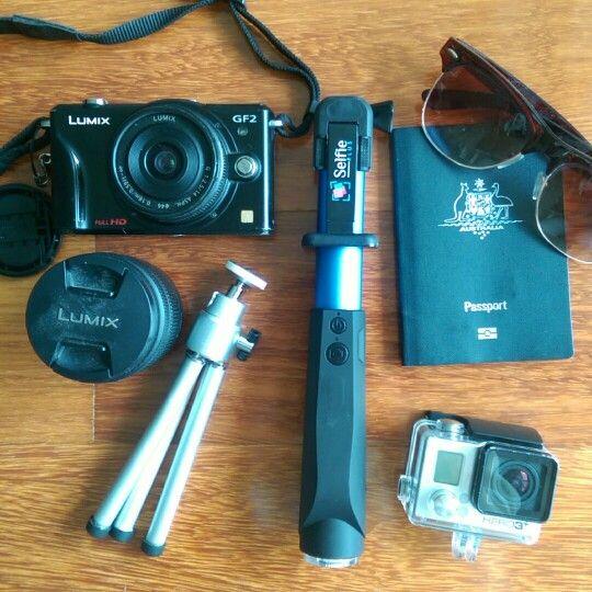 Travel kit- camera, tempus selfiestick, gopro, sunnies, passport, tripod
