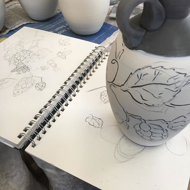 The gap between getting something down on paper and applying it to a pot can be a big one it's much harder to erase when doing sgraffito!  I've got some colour tests going in the kiln today for these sweet hops jugs here's hoping I can get these fired next week!  #pottery #ceramics #handmade #wip #hops #sketchbook