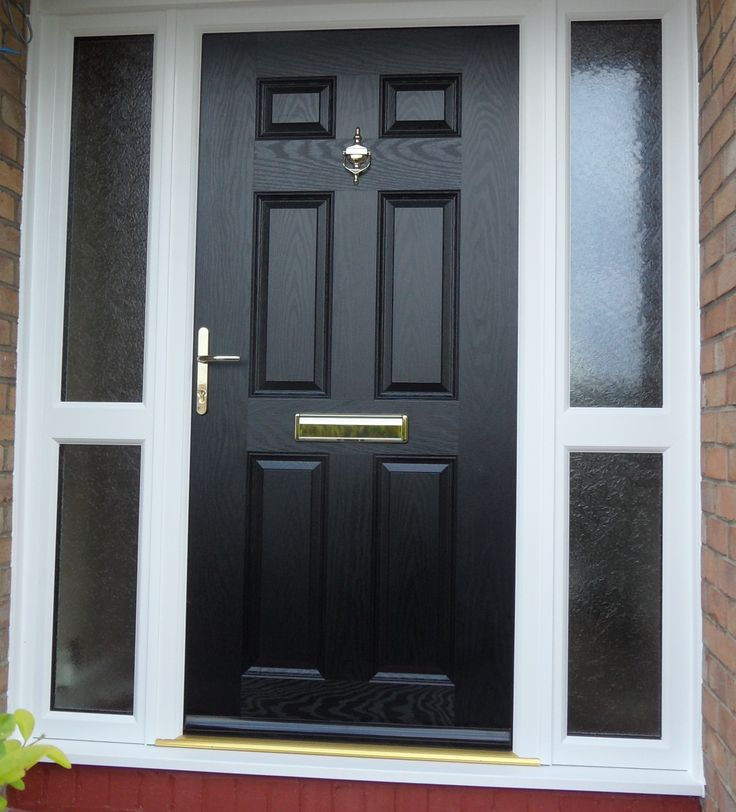 A black solid composite door with 2 glazed sidelights
