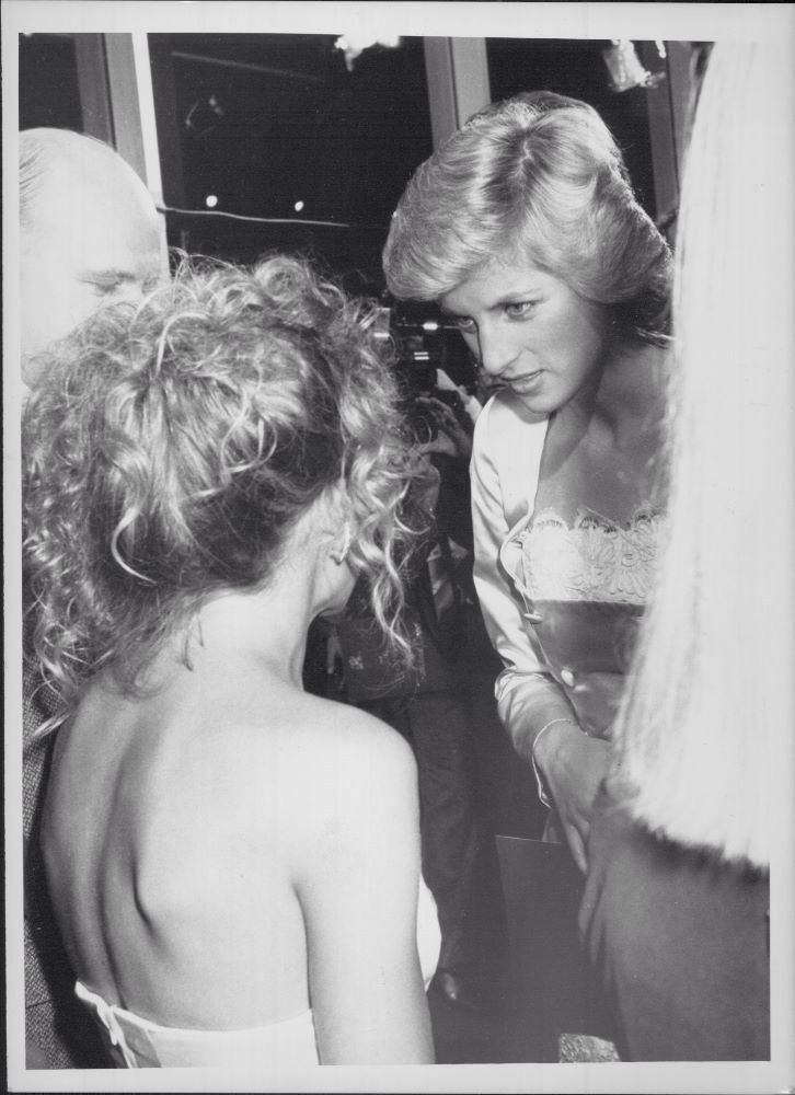 25 Jan 1988 Diana chats with Kylie Minogue in Sydney. The Princess had flown in with husband Charles earlier that day.
