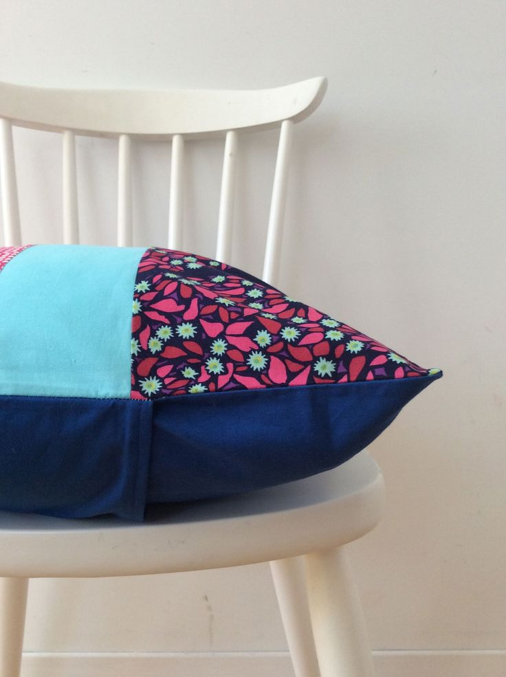 Colour block throw cover in many shades of blue.  https://www.etsy.com/ca/your/shops/scraphilldesigns