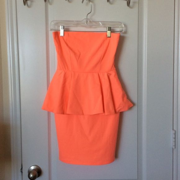 Neon Orange Peplum Strapless Dress from Zara This dress is in perfect condition! Worn only once in Vegas. It is perfect party / going-out dress and very flattering! Zara Dresses Strapless