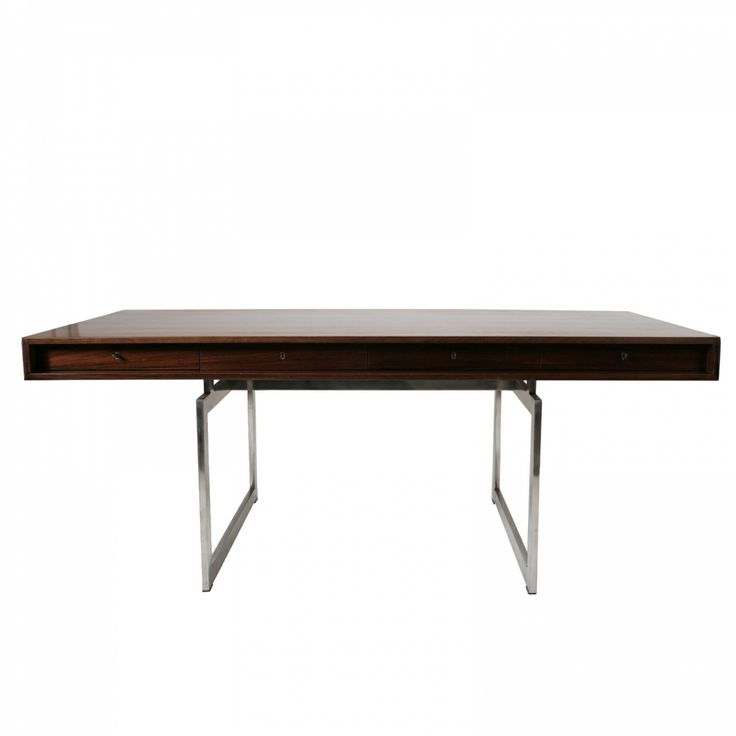Bodil Kjær  Desk  Designed in 1959  W: 185 cm · H: 71 cm · D: 92,50 cm  Materials: Rosewood and metal Manufacturer: E. Pedersen & son