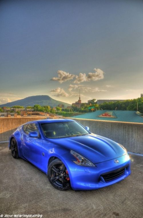 2013 Nissan 370Z. I absolutely love the blue paint with black rims contrast.