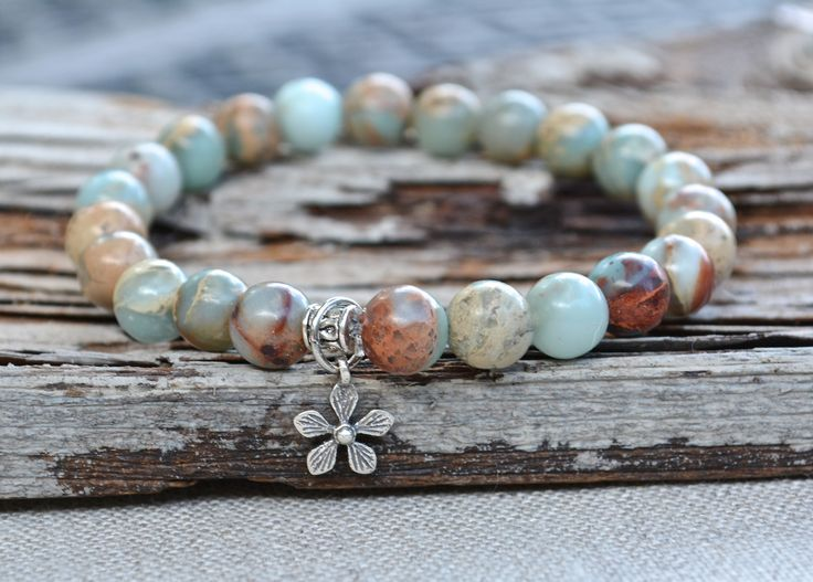 One gorgeous Aqua Terra Jasper gemstone stretch bracelet by Butterfly Warriors Jewelry. A delicate tiny sterling silver daisy charm is added for a touch of whimsy. *Small Sterling Silver 925 Daisy Flo