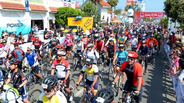 Cyclists launch from downtown Rosarito Beach during a previous Rosarito-Ensenada ride.