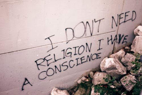 """I don't need religion, I have a conscience."" I am touched by the irony, but can't seem to think of a way of documenting it without sounding like I'm self-righteously out-doing someone who's exact beliefs are unknown to me. All I know is grafitti is illegal and so this statement has lost its weight."