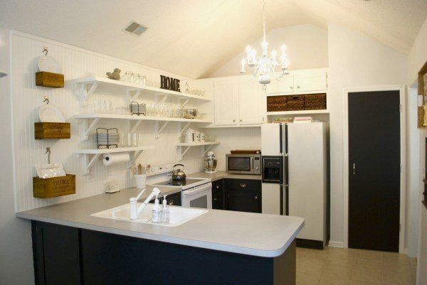 DIY Open Kitchen Shelves from Low Country Living The use of baskets above the refrigerator and on the wall